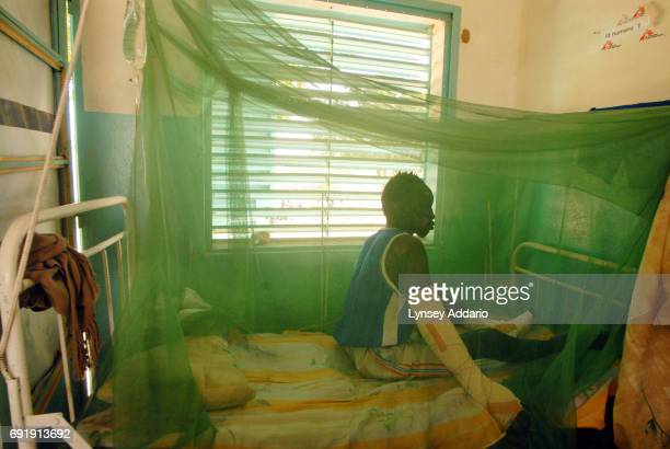 Yousef Hamiz a Sudanese rebel with the Justice and Equality Movement lies burned in a hospital in Iriba Chad October 15 2006 Hamiz was in a car with...