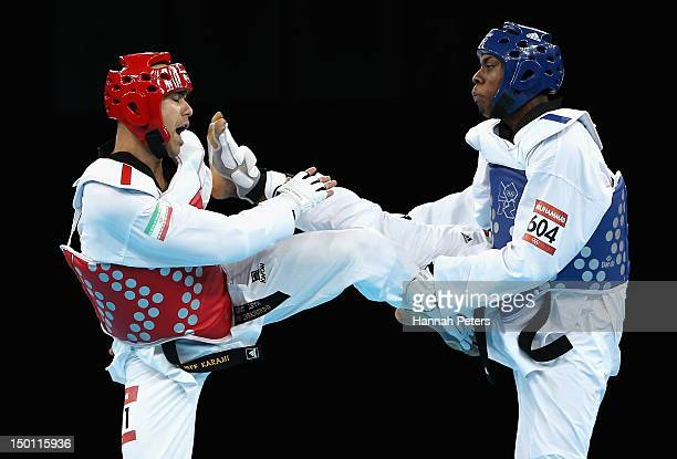 Yousef Karami of Islamic Republic of Iran competes against Lutalo Muhammad of Great Britain in the Men's 80kg Taekwondo Repechage bout on Day 14 of...