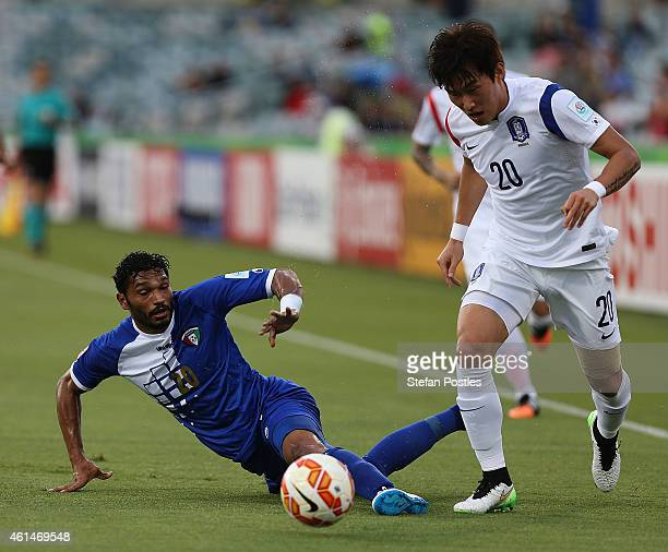 Yousef Naser Alsulaiman of Kuwait and Jang Hyunsoo of Korea Republic contest possession during the 2015 Asian Cup match between Kuwait and Korea...
