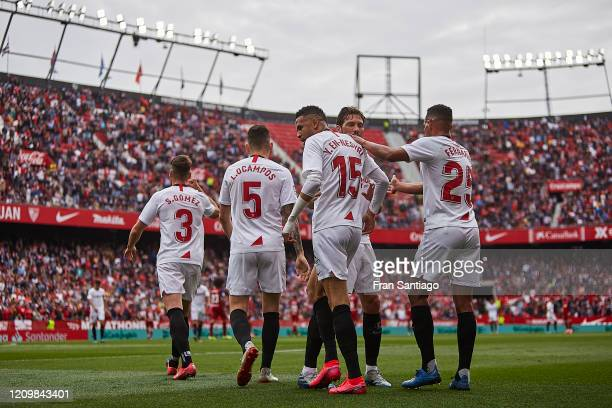 Youseff EnNesyri of Sevilla FC celebrates scoring his team's opening goal with team mates during the Liga match between Sevilla FC and CA Osasuna at...