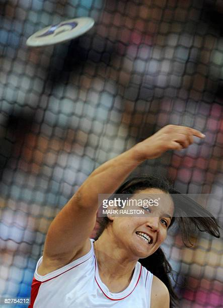 Yousra Ben Jemaa from Tunisia takes a throw during the final of the women's discus F3234 classification event at the 2008 Beijing Paralympic Games in...