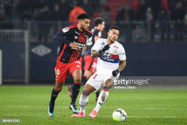 Youssef Ait Bennasser of Caen and Memphis Depay of Lyon during the Ligue 1 match between SM Caen and Olympique Lyonnais at Stade Michel D'Ornano on...