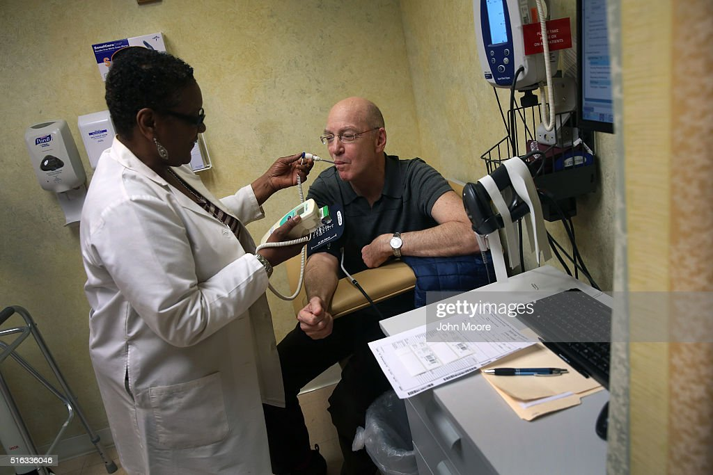 Youssef Cohen gets checked by a nurse before underdoing cancer treatment on March 16, 2016 in New York City. Cohen, 68, has an incurable cancer called mesothelioma and is advocating for the right to choose how and when he will die, proposed in New York State's End of Life Options Act, currently in front of the state legislature. Cohen is a professor of political science at New York University and is currently on sabbatical, due to his illness. He had his first bout with cancer in 2012 and has since undergone chemotherapy, surgery and radiation. He is currently taking immunotherapy infusions of the drug Keytruda in a final effort to fight the disease. The national 'right to die' movement is also known as 'death with dignity,' or called 'physician-assisted suicide' by opponents. It is now completely legal in 4 states, including California, where the new law goes into effect this June. If New York does not pass its legislation in time for Cohen's death, he and his wife say they are prepared to move to Oregon, the first state to make death with dignity legal, in order to insure that he dies without suffering.