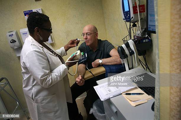 Youssef Cohen gets checked by a nurse before underdoing cancer treatment on March 16 2016 in New York City Cohen has an incurable cancer called...