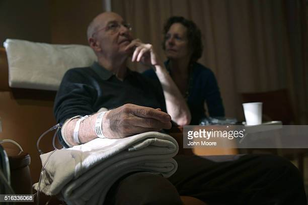 Youssef Cohen sits while undergoing cancer treatment as his wife Lindsay Wright looks on on March 17 2016 in New York City Cohen has an incurable...