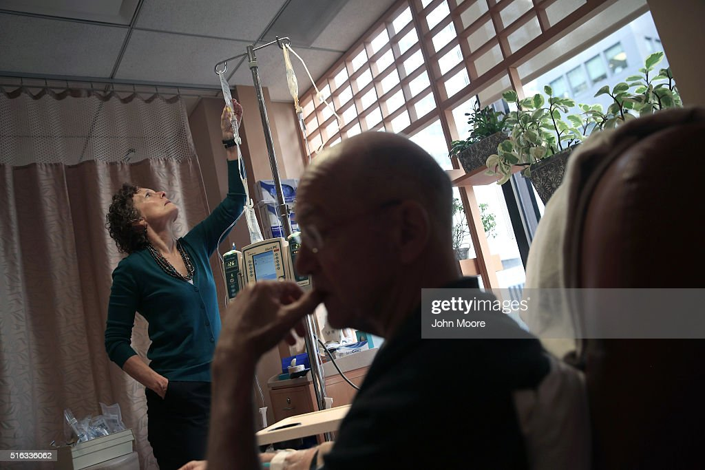 Youssef Cohen, 68, undergoes cancer treatment as his wife Lindsay Wright checks his medication drip on March 17, 2016 in New York City. Cohen has an incurable cancer called mesothelioma and is advocating for the right to choose how and when he will die, proposed in New York State's End of Life Options Act, currently in front of the state legislature. Cohen is a professor of political science at New York University and is currently on sabbatical, due to his illness. He had his first bout with cancer in 2012 and has since undergone chemotherapy, surgery and radiation. He is currently taking immunotherapy infusions of the drug Keytruda in a final effort to fight the disease. The national 'right to die' movement is also known as 'death with dignity,' or called 'physician-assisted suicide' by opponents. It is now completely legal in 4 states, including California, where the new law goes into effect this June. If New York does not pass its legislation in time for Cohen's death, he and his wife say they are prepared to move to Oregon, the first state to make death with dignity legal, in order to insure that he dies without suffering.