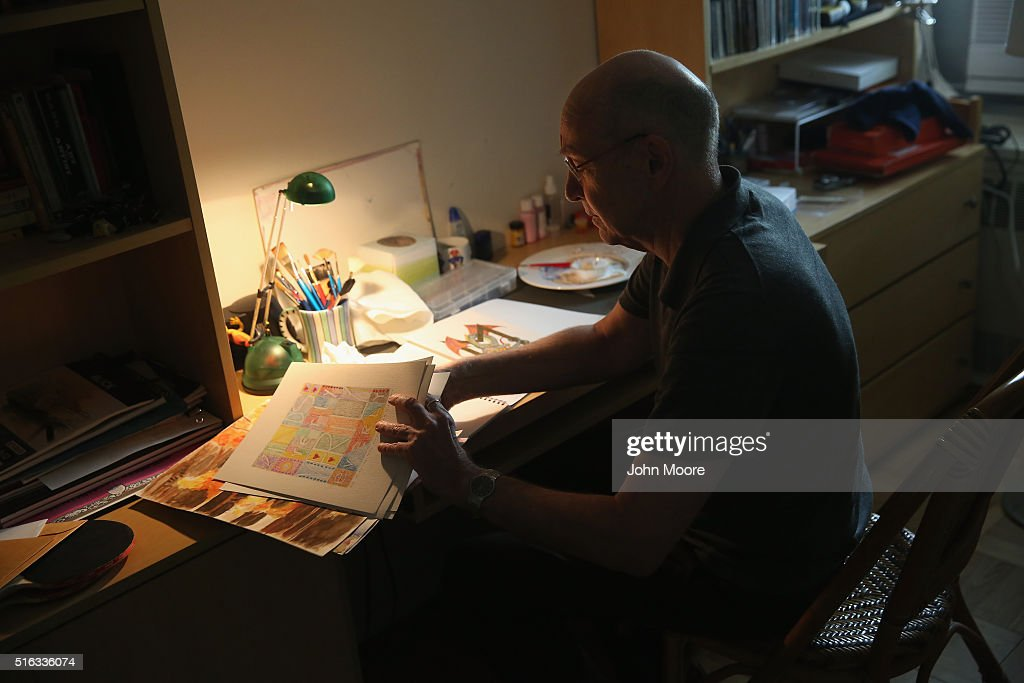 Youssef Cohen, who has an incurable cancer called mesothelioma, looks through his water-color paintings in his Manhattan apartment on March 16, 2016 in New York City. Cohen, 68, is advocating for the right to choose how and when he will die, proposed in New York State's End of Life Options Act, currently in front of the state legislature. Cohen is a professor of political science at New York University and is currently on sabbatical, due to his illness. He had his first bout with cancer in 2012 and has since undergone chemotherapy, surgery and radiation. He is currently taking immunotherapy infusions of the drug Keytruda in a final effort to fight the disease. The national 'right to die' movement is also known as 'death with dignity,' or called 'physician-assisted suicide' by opponents. It is now completely legal in 4 states, including California, where the new law goes into effect this June. If New York does not pass its legislation in time for Cohen's death, he and his wife say they are prepared to move to Oregon, the first state to make death with dignity legal, in order to insure that he dies without suffering.