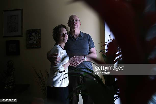 Youssef Cohen who has an incurable cancer called mesothelioma stands with his wife Lindsay Wright in their Manhattan apartment on March 16 2016 in...