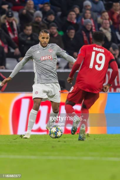 Youssef El Arabi of Olympiacos FC and Alphonso Davies of FC Bayern Muenchen battle for the ball during the UEFA Champions League group B match...