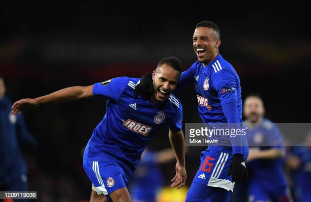 Youssef El Arabi of Olympiacos FC and Bruno Gaspar of Olympiacos FC celebrate victory after the UEFA Europa League round of 32 second leg match...