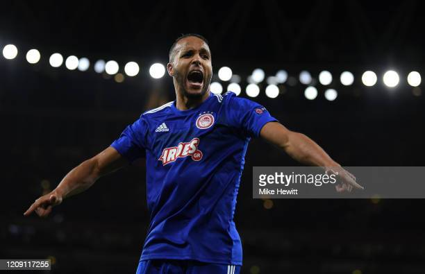 Youssef El Arabi of Olympiacos FC celebrates after scoring his team's second goal in extratime during the UEFA Europa League round of 32 second leg...