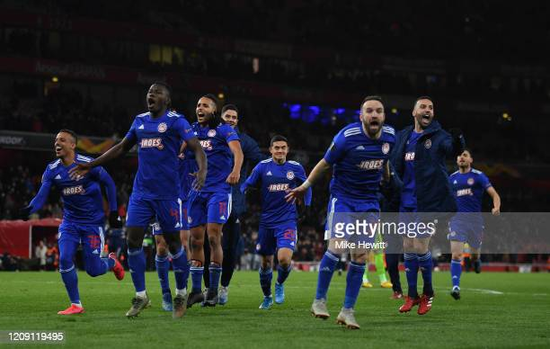 Youssef El Arabi of Olympiacos FC celebrates victory with his teammates after the UEFA Europa League round of 32 second leg match between Arsenal FC...