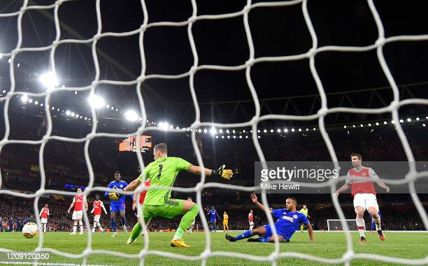 Youssef El Arabi of Olympiacos FC scores his team's second goal in extratime during the UEFA Europa League round of 32 second leg match between...