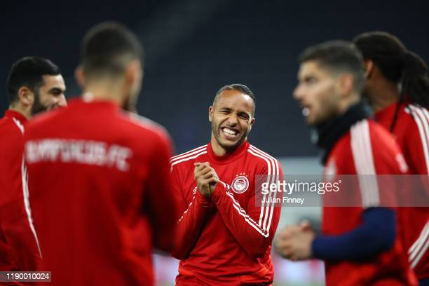 Youssef El Arabi of Olympiacos reacts during a training session ahead of their UEFA Champions League Group B match against Tottenham Hotspur at...