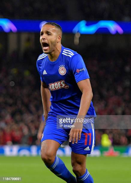 Youssef El Arabi of Olympiakos Piraeus celebrates after scoring during the UEFA Champions League group B match between Tottenham Hotspur and...