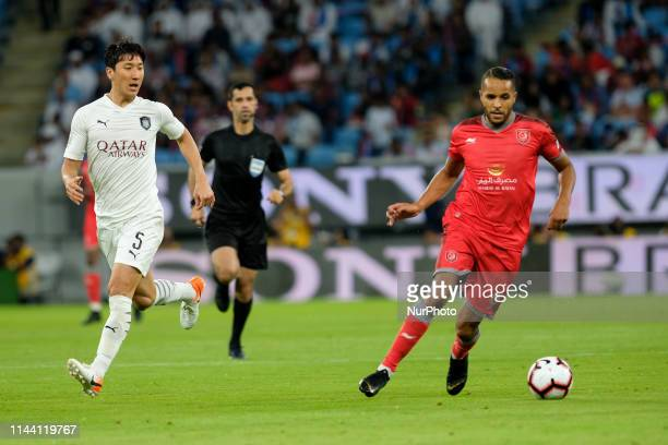 Youssef ElArabi is followed by Jung Wooyoung during the Amir Cup Final at the Al Wakrah Stadium in Doha Qatar on 16 May 2019