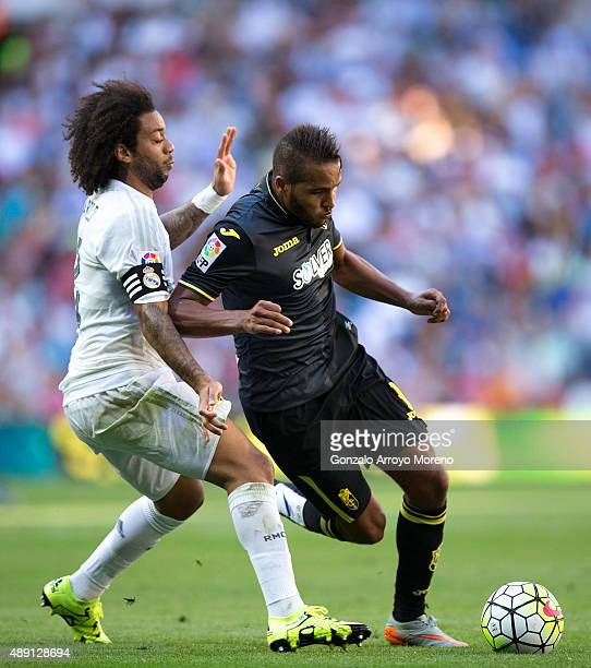 Youssef ElArabi of Granada CF competes for the ball with Marcelo of Real Madrid CF during the La Liga match between Real Madrid CF and Granada CF at...