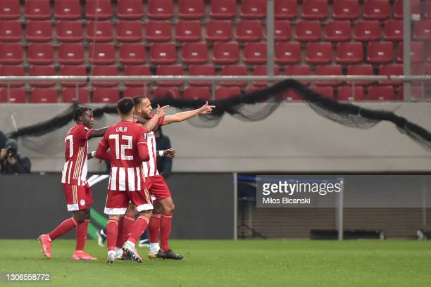 Youssef El-Arabi of Olympiacos FC celebrates with teammates Bruma and Kenny Lala after scoring their team's first goal during the UEFA Europa League...