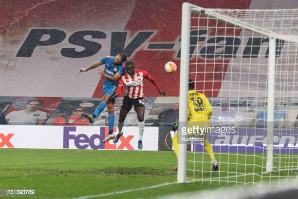 Youssef El-Arabi of Olympiacos, Jordan Teze, Yvon Mvogo of PSV during the UEFA Europa League Round of 32 match between PSV Eindhoven and Olympiakos...
