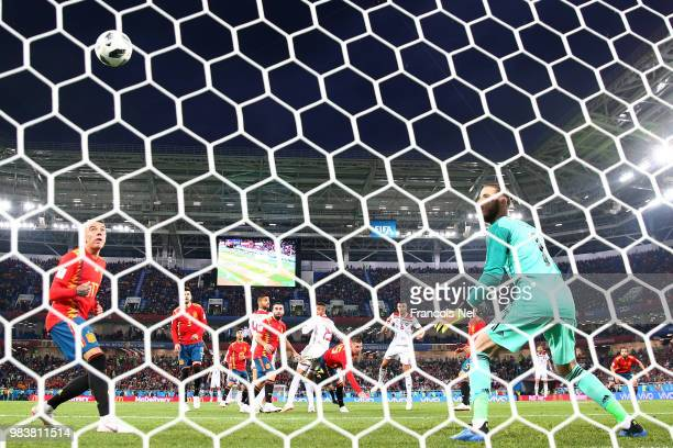 Youssef En Nesyri of Morocco scores his team's second goal past David De Gea of Spain during the 2018 FIFA World Cup Russia group B match between...
