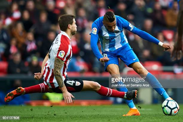 Youssef EnNesyri of Malaga CF competes for the ball with Inigo Martinez of Athletic Club during the La Liga match between Athletic Club Bilbao and...