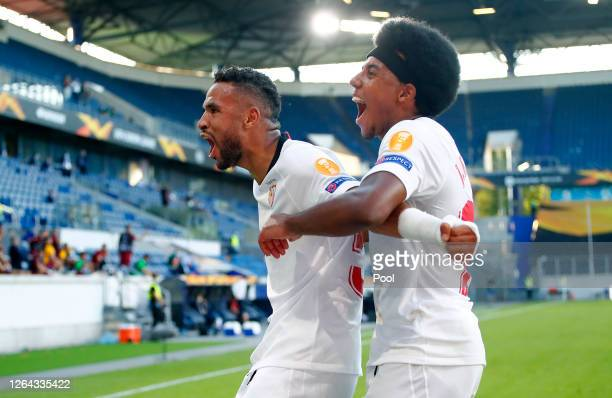 Youssef EnNesyri of Sevilla celebrates with Jules Kounde after he scores his sides second goal during the UEFA Europa League round of 16 singleleg...