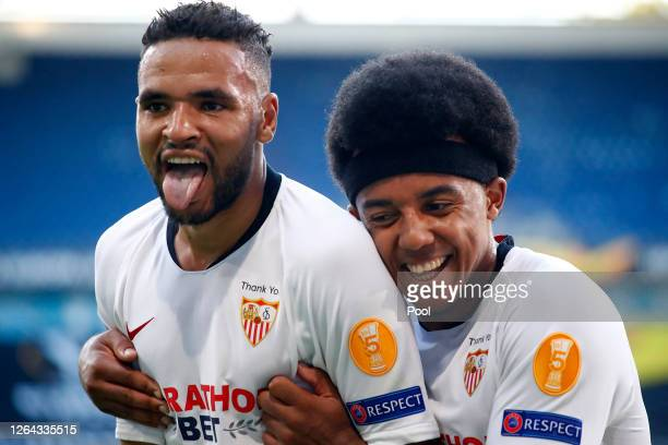 Youssef En-Nesyri of Sevilla celebrates with Jules Kounde after he scores his sides second goal during the UEFA Europa League round of 16 single-leg...