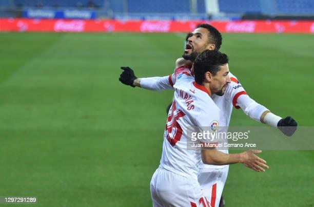 Youssef En-Nesyri of Sevilla celebrates with team mate Jesus Navas after scoring their side's first goal during the La Liga Santander match between...