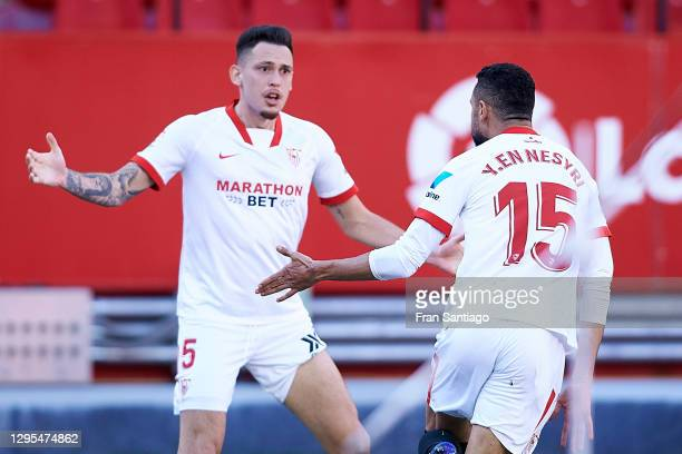 Youssef En-Nesyri of Sevilla celebrates with teammate Lucas Ocampos after scoring his team's third goal, completing his hat-trick during the La Liga...