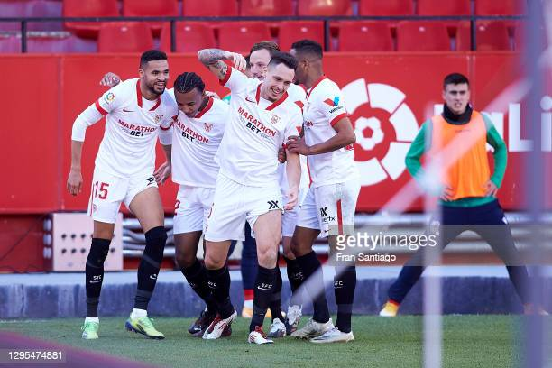 Youssef En-Nesyri of Sevilla celebrates with teammates after scoring his team's third goal, completing his hat-trick during the La Liga Santander...