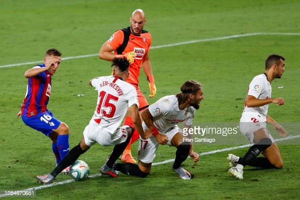 Youssef En-Nesyri of Sevilla FC blocks a shot by Pablo de Blasis of SD Eibar during the Liga match between Sevilla FC and SD Eibar SAD at Estadio...