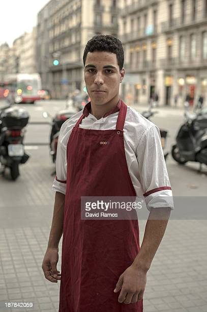 Youssef from Morocco poses for a portrait outside the restaurant where he is gaining work experience on October 30 2013 in Barcelona Spain Youssef...