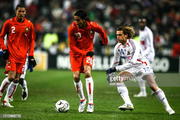 Youssef HADJI of Morocco and Jerome ROTHEN of France during the International Friendly match between France and Morocco at Stade de France Paris...