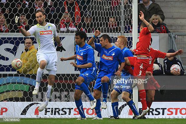 Youssef Mohamad of Koeln scores his team's first goal against goalkeeper Tom Starke of Hoffenheim during the Bundesliga match between 1899 Hoffenheim...