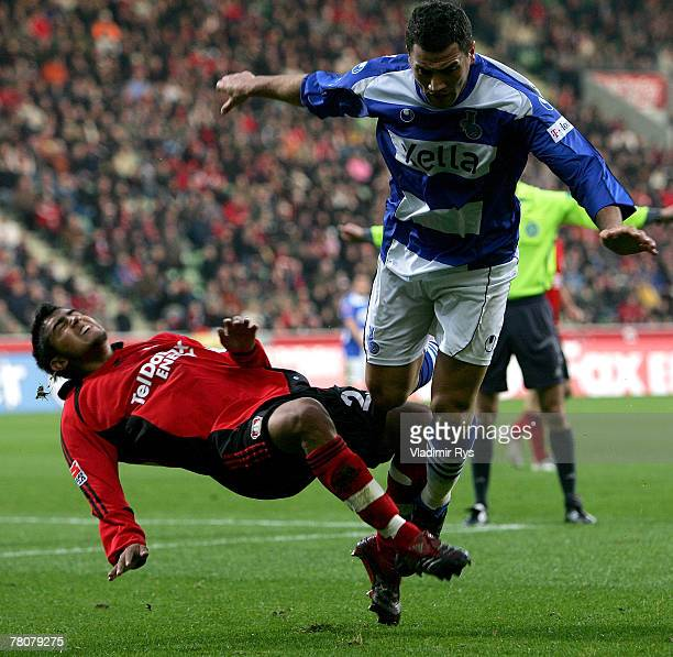 Youssef Mokhtari of Duisburg fouls Arturo Vidal of Leverkusen during the Bundesliga match between Bayer Leverkusen and MSV Duisburg at the BayArena...