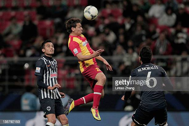 Youssef Msakni of Esperance Sportive de Tunis heads the ball during the FIFA Club World Cup 5th Place match between Club de Futbol Monterrey and...