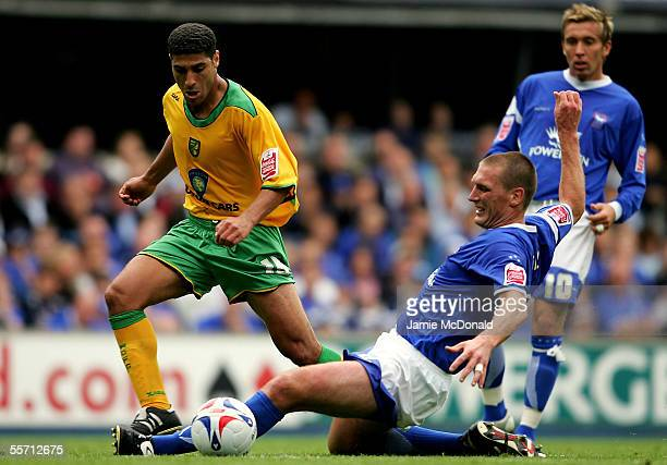 Youssef Safri of Norwich is tackled by Jason De Vos of Ipswich during the CocaCola Championship match between Ipswich Town and Norwich City at...