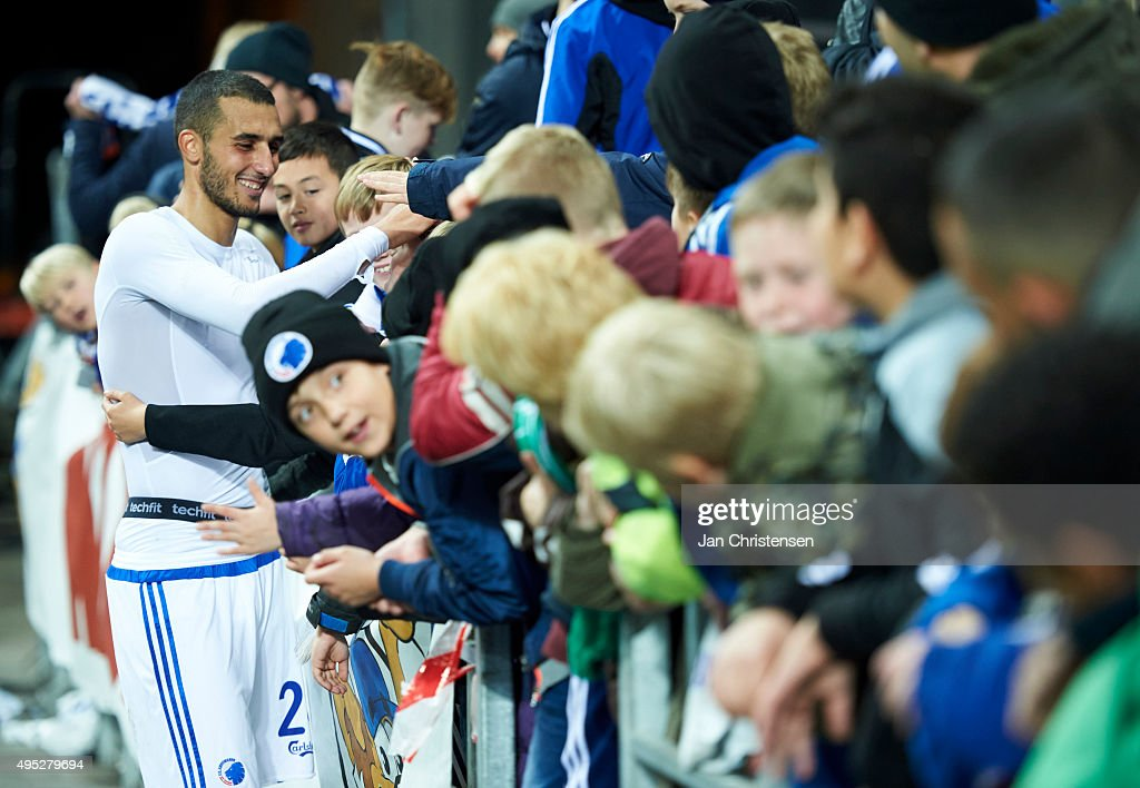 Youssef Toutouh of FC Copenhagen celebrate with fans after the Danish Alka Superliga match between FC Copenhagen and Randers FC at Telia Parken Stadium on November 01, 2015 in Copenhagen, Denmark.