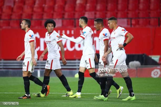 Yousseff En-Nesyri of Sevilla celebrates with team mates after scoring their side's first goal during the La Liga Santander match between Sevilla FC...