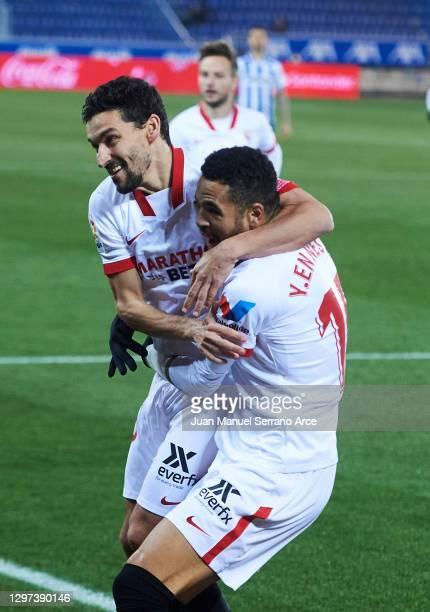 Yousseff En-Nesyri of Sevilla FC celebrates with his teammate Jesus Navas Gonzalez of Sevilla FC after scoring the opening goal during the La Liga...