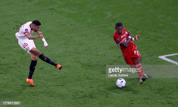 Yousseff En-Nesyri of Sevilla FC is blocked by David Alaba of Bayern Munich during the UEFA Super Cup match between FC Bayern Munich and FC Sevilla...