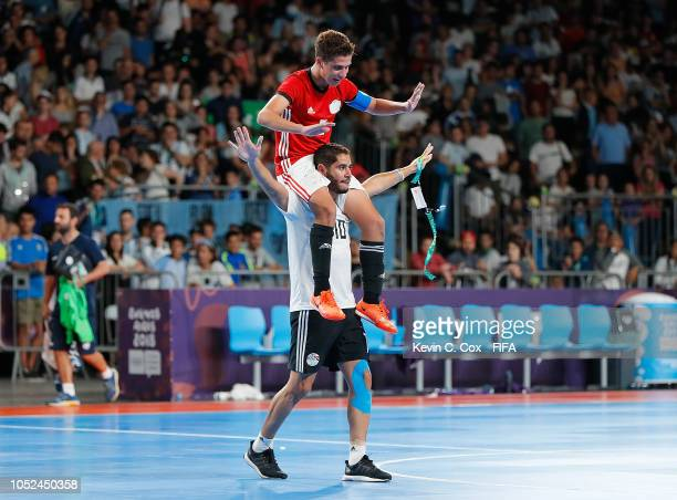 Youssif Mohsen and Mohamed Ahmed of Egypt celebrate their 54 win over Argentina in the Men's Futsal 3rd Place match between Egypt and Argentina...