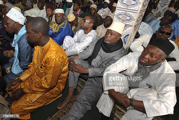 Youssou N'dour Alioune Tine and Mamadou Lamine Diallo of the M23 movment sit with members of the Tidianes Muslim brotherhood in the Zawiyia El Hadj...