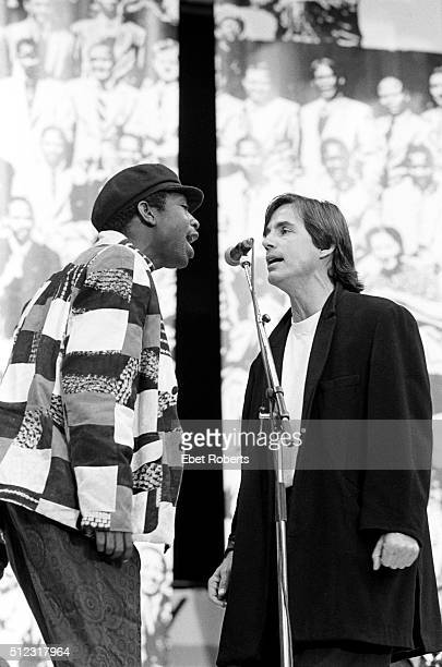 Youssou N'Dour and Jackson Browne performing at Wembley Stadium in London England for the Nelson Mandela 70th Birthday Tribute Concert on June 11 1988