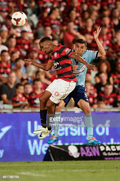 Youssouf Hersi of the Wanderers and Ali Abbas of Sydney jump for a high ball during the round 14 ALeague match between the Western Sydney Wanderers...