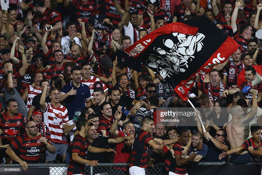 Youssouf Hersi of the Wanderers celebrates with the crowd and his team mates after scoring a goal during the round 20 A-League match between the Western Sydney Wanderers and the Newcastle Jets at Campbelltown Sports Stadium on February 9, 2013 in Sydney, Australia.