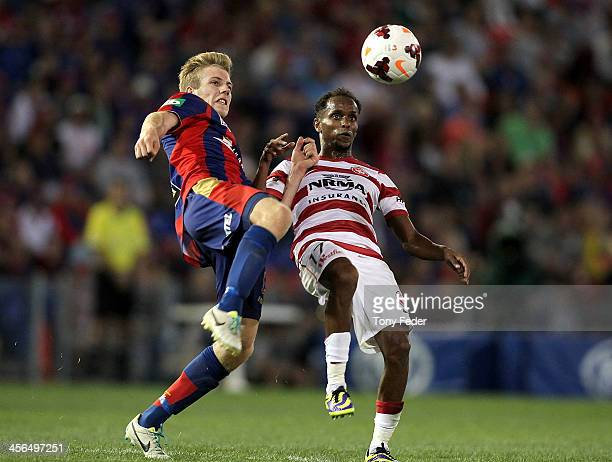 Youssouf Hersi of the Wanderers contests the ball against Andrew Hoole of the Jets during the round 10 A-League match between the Newcastle Jets and...