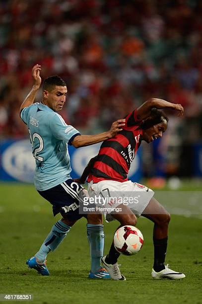 Youssouf Hersi of the Wanderers is tackled by Ali Abbas of Sydney during the round 14 ALeague match between the Western Sydney Wanderers and Sydney...
