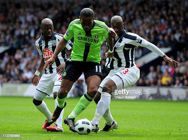 Youssouf Mulumbu and Abdoulaye Meite of West Bromwich Albion challenge Didier Drogba of Chelsea during the Barclays Premier League match between West...