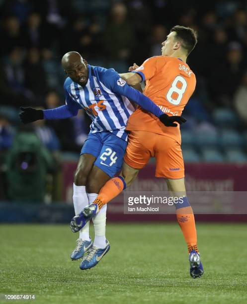 Youssouf Mulumbu of Kilmarnock vies with Ryan Jack of Rangers during the Scottish Cup 5th Round match between Kilmarnock and Rangers at Rugby Park on...
